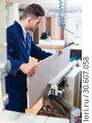Young working man practising his skills with milling cutter. Стоковое фото, фотограф Яков Филимонов / Фотобанк Лори