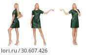 Купить «Young woman in green dress isolated on white», фото № 30607426, снято 22 сентября 2014 г. (c) Elnur / Фотобанк Лори