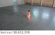 Купить «Ballet training indoors. Young beautiful woman ballerina dancing in the pointe shoes holding a strip», видеоролик № 30612318, снято 27 мая 2020 г. (c) Константин Шишкин / Фотобанк Лори
