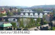 Купить «Вид на пражские мосты апрельским днем. Прага, Чехия», видеоролик № 30616662, снято 21 апреля 2018 г. (c) Виктор Карасев / Фотобанк Лори