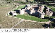 Купить «Aerial view of Catalan fortress Fort de Salses at sunny day, France», видеоролик № 30616974, снято 3 января 2019 г. (c) Яков Филимонов / Фотобанк Лори