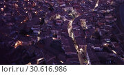 Купить «Evening aerial view of medieval Spanish town of Daroca with gate Puerta Baja on main city street», видеоролик № 30616986, снято 9 марта 2019 г. (c) Яков Филимонов / Фотобанк Лори