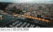 Купить «View from drones of sailboats and yachts in old port of Barcelona and gothic quarter at night», видеоролик № 30616994, снято 28 сентября 2018 г. (c) Яков Филимонов / Фотобанк Лори