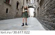 Купить «Cheerful young girl s making photo with phone at street in Barcelona», видеоролик № 30617022, снято 27 октября 2018 г. (c) Яков Филимонов / Фотобанк Лори