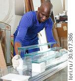 Купить «Portrait of professional African-American man working in glass workshop», фото № 30617386, снято 16 мая 2018 г. (c) Яков Филимонов / Фотобанк Лори