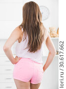 Купить «Back view of girl in tight shorts», фото № 30617662, снято 24 июня 2017 г. (c) Яков Филимонов / Фотобанк Лори