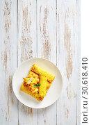 Купить «crepes roll up filled with sweet white cheese», фото № 30618410, снято 6 марта 2019 г. (c) Oksana Zh / Фотобанк Лори