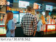 Friends choosing food in cinema bar. Стоковое фото, фотограф Tryapitsyn Sergiy / Фотобанк Лори