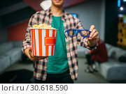 Male spectator with 3d glasses and popcorn, cinema. Стоковое фото, фотограф Tryapitsyn Sergiy / Фотобанк Лори