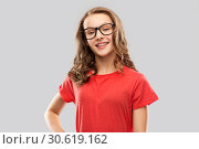 Купить «smiling student girl in glasses and red t-shirt», фото № 30619162, снято 17 февраля 2019 г. (c) Syda Productions / Фотобанк Лори