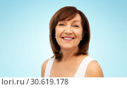 Купить «portrait of smiling senior woman over white», фото № 30619178, снято 8 февраля 2019 г. (c) Syda Productions / Фотобанк Лори
