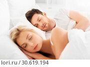 Купить «happy couple sleeping in bed at home», фото № 30619194, снято 25 февраля 2016 г. (c) Syda Productions / Фотобанк Лори