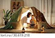Купить «family with tablet pc in kids tent at home», фото № 30619218, снято 27 января 2018 г. (c) Syda Productions / Фотобанк Лори