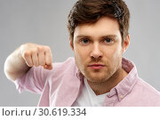 Купить «angry young man ready for fist punch», фото № 30619334, снято 3 февраля 2019 г. (c) Syda Productions / Фотобанк Лори