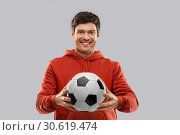 Купить «happy man or football fan with soccer ball», фото № 30619474, снято 3 февраля 2019 г. (c) Syda Productions / Фотобанк Лори