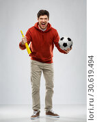Купить «man or football fan with soccer ball and vuvuzela», фото № 30619494, снято 3 февраля 2019 г. (c) Syda Productions / Фотобанк Лори