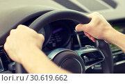 Купить «close up of male hands driving car», фото № 30619662, снято 12 июня 2016 г. (c) Syda Productions / Фотобанк Лори