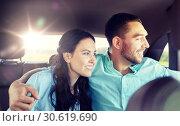 Купить «happy man and woman hugging on taxi back seat», фото № 30619690, снято 12 июня 2016 г. (c) Syda Productions / Фотобанк Лори