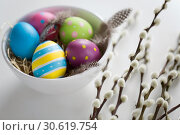 Купить «colored easter eggs and pussy willow branches», фото № 30619754, снято 22 марта 2018 г. (c) Syda Productions / Фотобанк Лори