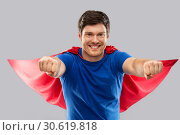 Купить «man in red superhero cape over grey background», фото № 30619818, снято 3 февраля 2019 г. (c) Syda Productions / Фотобанк Лори