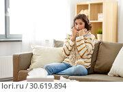Купить «sad sick woman in scarf at home», фото № 30619894, снято 6 марта 2019 г. (c) Syda Productions / Фотобанк Лори