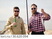 Купить «happy friends with fishing rods and beer on pier», фото № 30620094, снято 8 сентября 2018 г. (c) Syda Productions / Фотобанк Лори