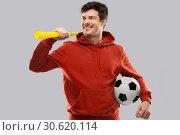 Купить «man or football fan with soccer ball and vuvuzela», фото № 30620114, снято 3 февраля 2019 г. (c) Syda Productions / Фотобанк Лори