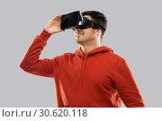 Купить «happy man in virtual reality headset or vr glasses», фото № 30620118, снято 3 февраля 2019 г. (c) Syda Productions / Фотобанк Лори