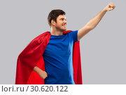 Купить «man in red superhero cape over grey background», фото № 30620122, снято 3 февраля 2019 г. (c) Syda Productions / Фотобанк Лори