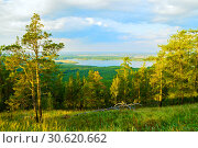 Купить «Forest landscape with mixed forest trees on the mountain slopes and distant lake under soft sunset light», фото № 30620662, снято 23 августа 2013 г. (c) Зезелина Марина / Фотобанк Лори