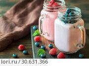 Купить «Blueberry and raspberry smoothies», фото № 30631366, снято 23 июля 2017 г. (c) easy Fotostock / Фотобанк Лори