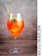 Купить «Glass of Aperol Spritz cocktail», фото № 30631374, снято 27 июля 2017 г. (c) easy Fotostock / Фотобанк Лори