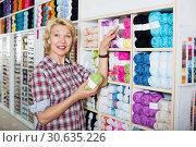 Купить «Woman buying yarn in store», фото № 30635226, снято 18 июля 2019 г. (c) Яков Филимонов / Фотобанк Лори