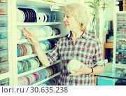Купить «Woman selecting lacing ribbon», фото № 30635238, снято 18 июля 2019 г. (c) Яков Филимонов / Фотобанк Лори