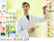Купить «Male technician working in pharmacy depot», фото № 30635254, снято 25 мая 2019 г. (c) Яков Филимонов / Фотобанк Лори