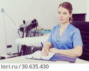 Cosmetologist working with documents. Стоковое фото, фотограф Яков Филимонов / Фотобанк Лори