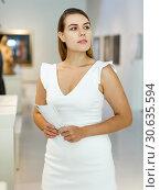 Купить «Woman observing museum exposition», фото № 30635594, снято 28 июля 2018 г. (c) Яков Филимонов / Фотобанк Лори