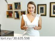 Купить «Woman observing museum exposition», фото № 30635598, снято 28 июля 2018 г. (c) Яков Филимонов / Фотобанк Лори
