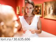 Купить «Woman observing museum exposition», фото № 30635606, снято 28 июля 2018 г. (c) Яков Филимонов / Фотобанк Лори
