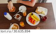 Купить «Table with morning breakfast top view», видеоролик № 30635894, снято 12 января 2019 г. (c) Ekaterina Demidova / Фотобанк Лори