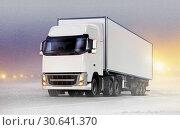 Купить «White truck on ice road in blizzard», фото № 30641370, снято 24 октября 2017 г. (c) easy Fotostock / Фотобанк Лори