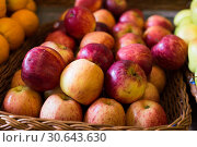 Купить «appetizing apples on counter in market», фото № 30643630, снято 26 мая 2018 г. (c) Татьяна Яцевич / Фотобанк Лори