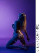 Купить «Nude girl wrapped in transparent film shot», фото № 30644402, снято 17 апреля 2019 г. (c) Гурьянов Андрей / Фотобанк Лори