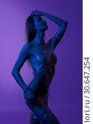 Купить «Naked woman wrapped in transparent film shot», фото № 30647254, снято 17 апреля 2019 г. (c) Гурьянов Андрей / Фотобанк Лори
