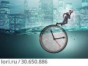 Купить «Businessman in deadline and time management concept», фото № 30650886, снято 30 июня 2020 г. (c) Elnur / Фотобанк Лори