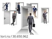 Купить «Businessman in uncertainty concept with many doors», фото № 30650962, снято 18 июня 2019 г. (c) Elnur / Фотобанк Лори