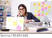 Купить «Young female employee in conflicting priorities concept», фото № 30651642, снято 21 января 2019 г. (c) Elnur / Фотобанк Лори
