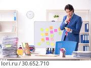Купить «Young male handsome employee in conflicting priorities concept», фото № 30652710, снято 7 января 2019 г. (c) Elnur / Фотобанк Лори