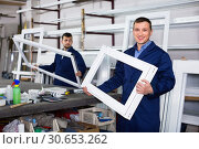 Workmen inspecting PVC manufacturing output in workshop. Стоковое фото, фотограф Яков Филимонов / Фотобанк Лори