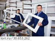 Купить «Workmen inspecting PVC manufacturing output in workshop», фото № 30653262, снято 30 марта 2017 г. (c) Яков Филимонов / Фотобанк Лори